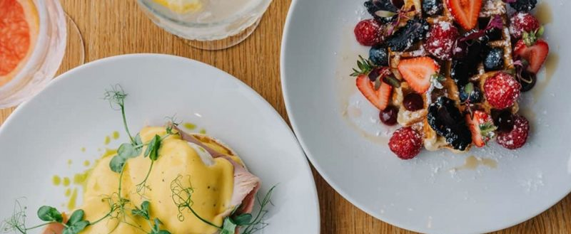 Eggs Benedict and waffles brunch served at The Water's Edge at the Greenbank Hotel in Falmouth UK