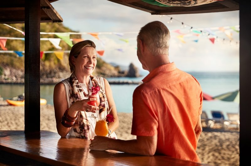Couple enjoying drinks on St Kitts beach