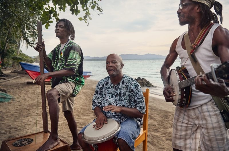 A band playing on a sandy beach in the Caribbean