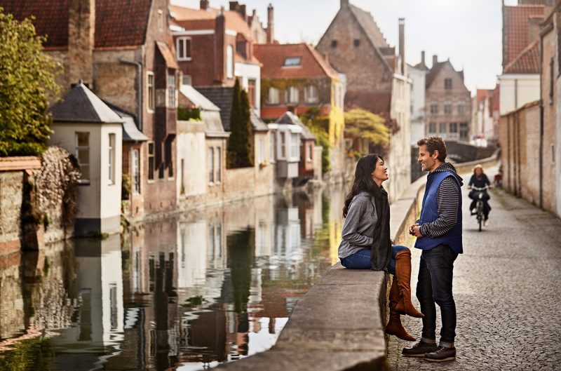 Couple on waterfront in Bruges