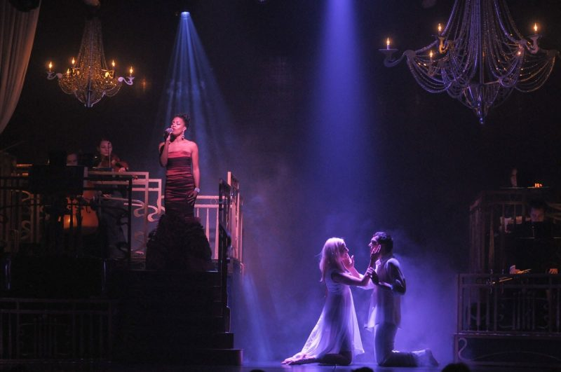 Performers on stage singing and dancing at the Bravo Theater Show onboard Princess Cruises