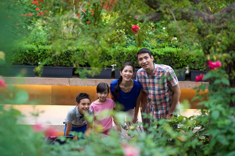 A family looking at the flowers in Gardens by the Bay Singapore