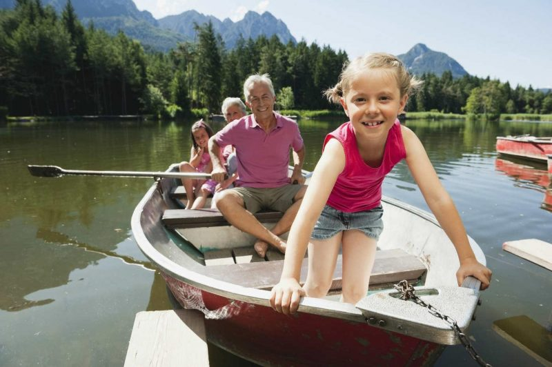Grandfather and granddaughter on a canoe