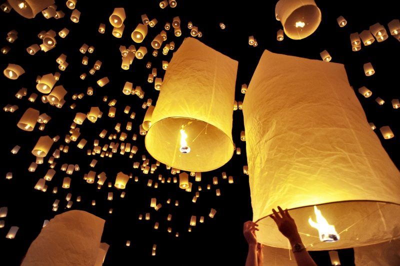 Traditional fire lanterns being released into the night sky