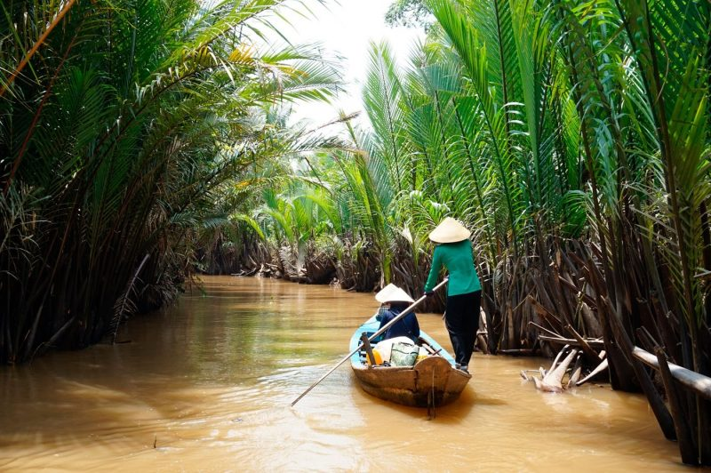Two people in a boat on the Mekong Delta Vietnam