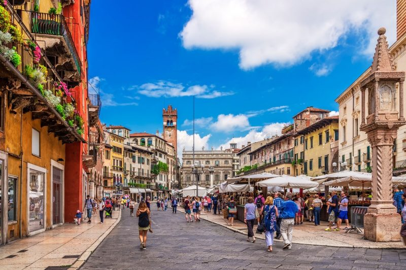 People milling about in the Piazza delle Erbe in Verona