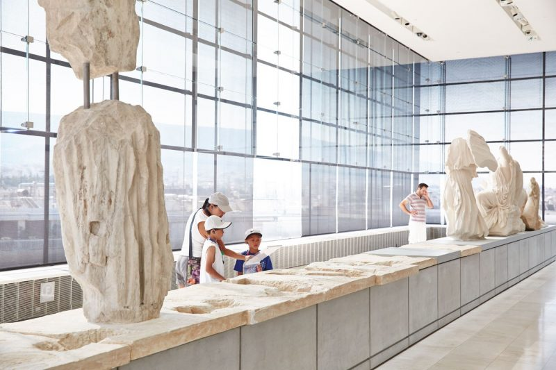 A family enjoying a visit to the Acropolis Museum in Athens