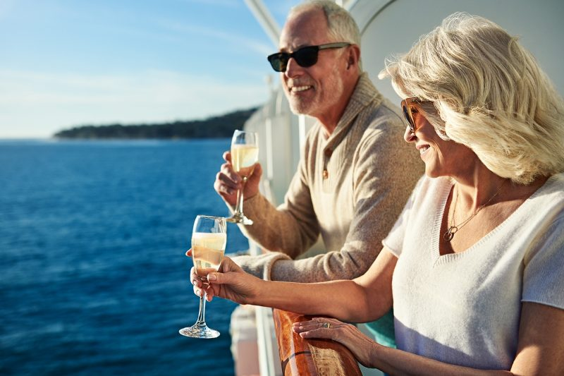 Couple enjoying champagne on a balcony