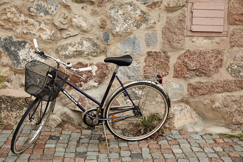 A bicyle against a wall