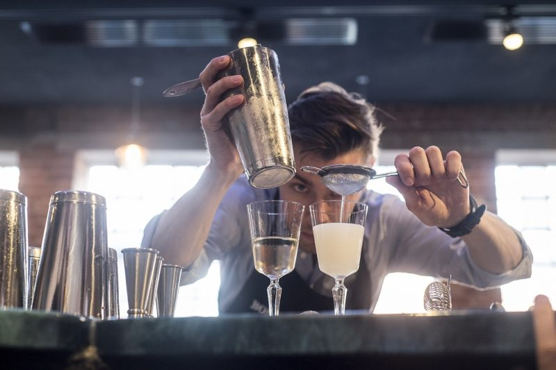 Man making gin cocktail at Bombay Sapphire