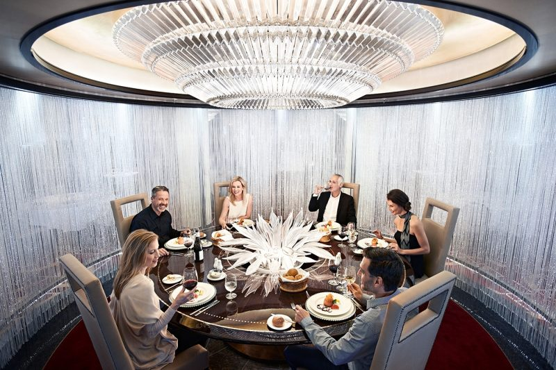 Group of six people eating dinner