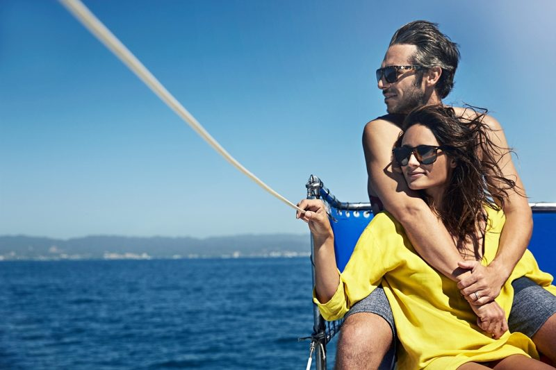 Couple wearing sunglasses on boat