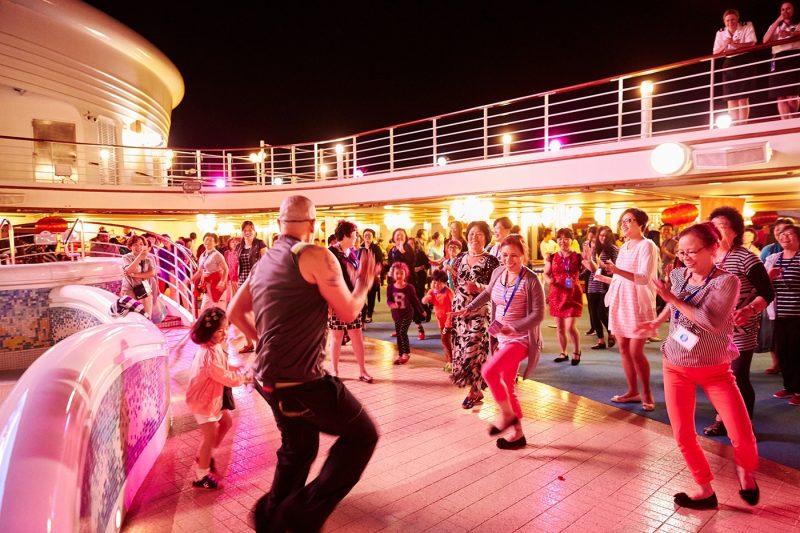 Princess line dancing on deck