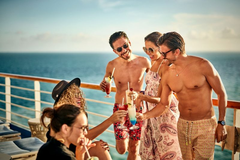 A group of friends enjoying drinks onboard Princess