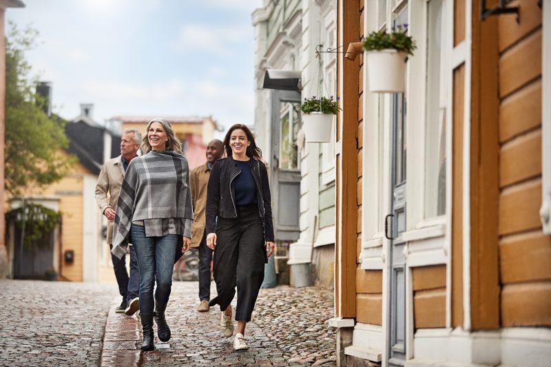 Friends walking in Helsinki in the daytime