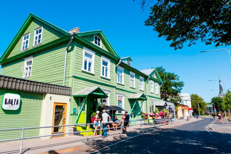 A street scene with brightly coloured buildings in Kalamaja, Tallin