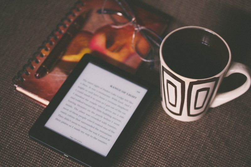 A kindle and a coffee still life