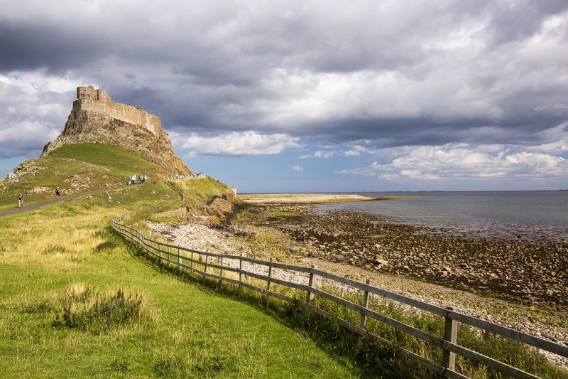 People walking to Lindisfarne Castle