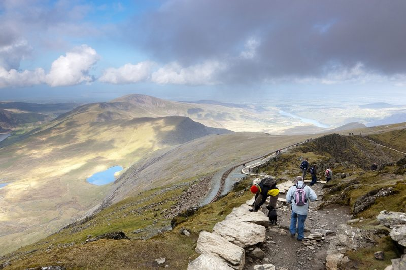 People walking along the Llanberis Path one of the routes up Snowdon