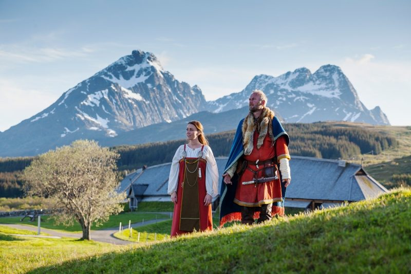 Two people in historic dress at the Lofotr Viking Museum in the Lofoten Islands