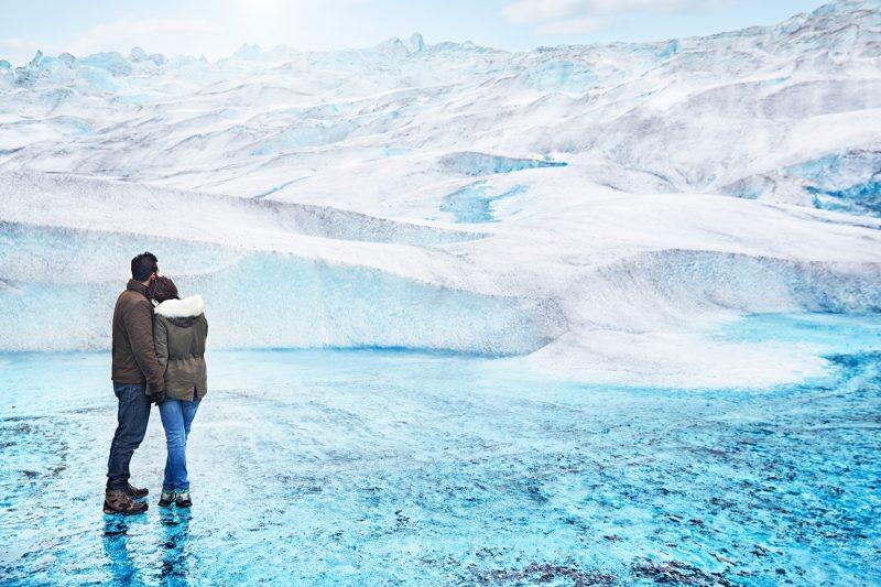 Two people standing on Medenhall Glacier, Alaska