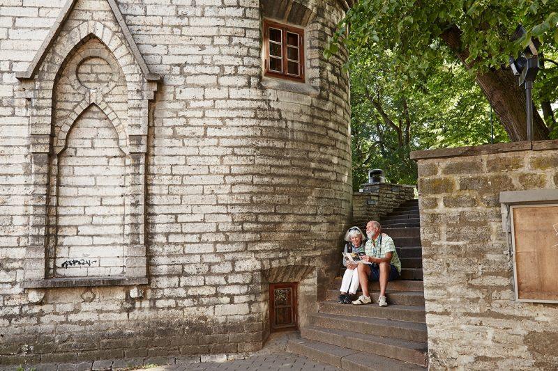 Couple sitting in Old Town, Tallinn