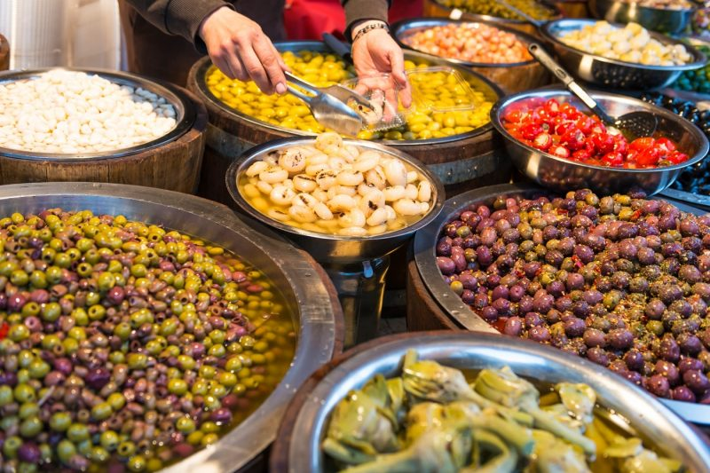 Someone serving olives from a stall in Catania Italy