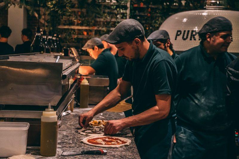 Pizza chef making pizza at Purezza