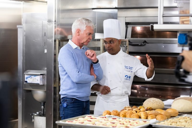 Phillip Schofield in conversation with a pastry chef onboard a Princess ship