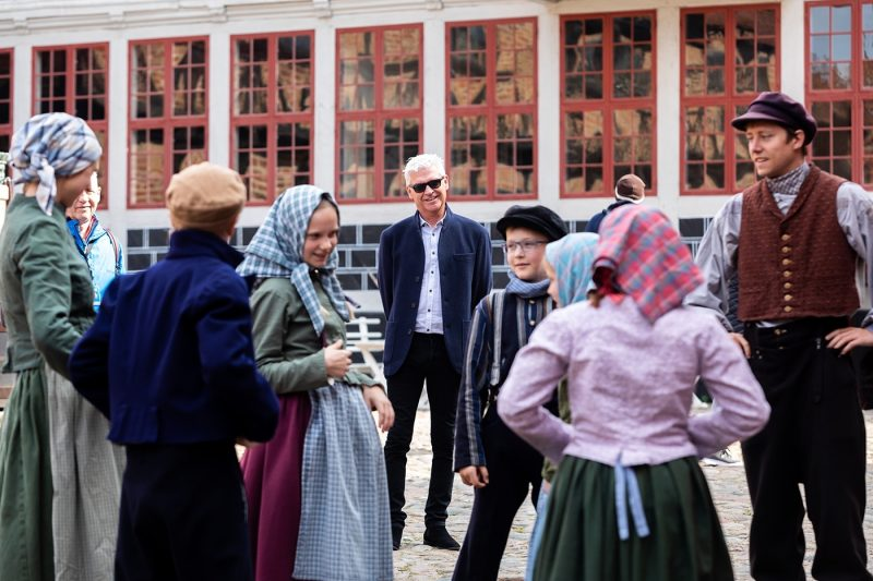 Phillip with staff in period costumes at Den Gamle By open-air museum