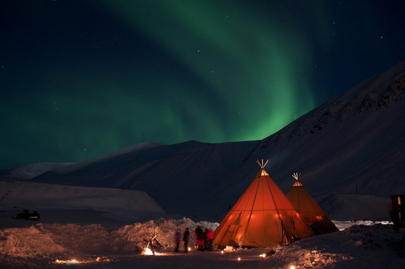 Northern lights in a tent in Svalbard