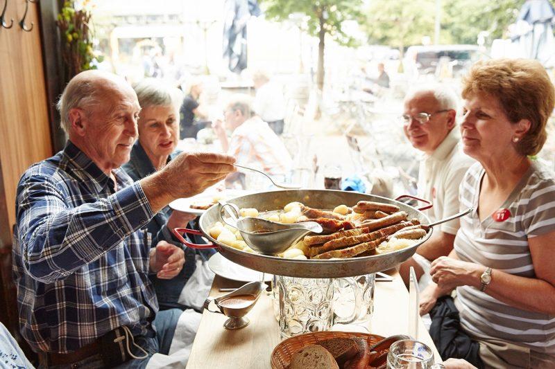 Group of friends enjoying food