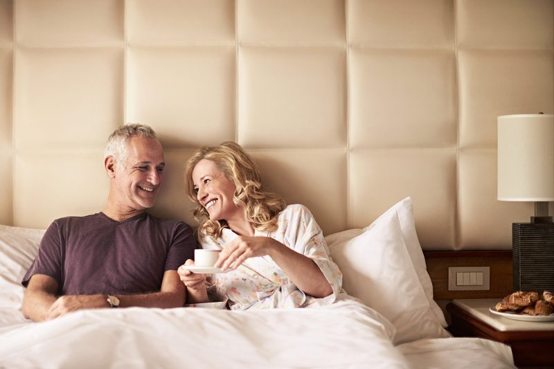 Couple in bed in stateroom