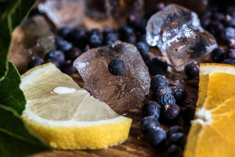 Gin making, Juniper berries, ice, lemon