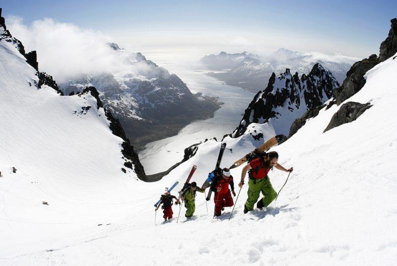 Four people hiking in Lofoten Fjords