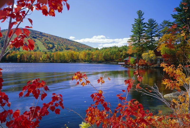 Fall colours, Moose Pond, with Mount Pleasant in the background, Maine, New England, USA