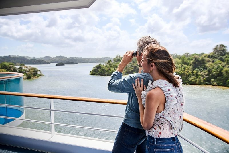 Couple sightseeing onboard ship in Panama canal