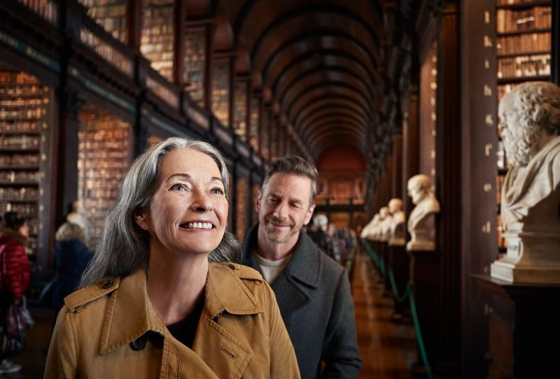 Couple enjoying Trinity College library