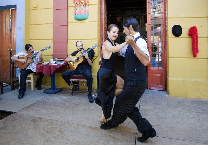 Couple dancing in La Boca district of Buenos Aires