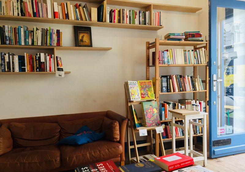 Bookshop with shelves, and a sofa