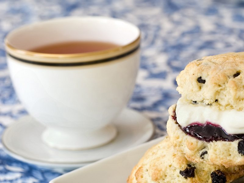Tea and scone with clotted cream and jam