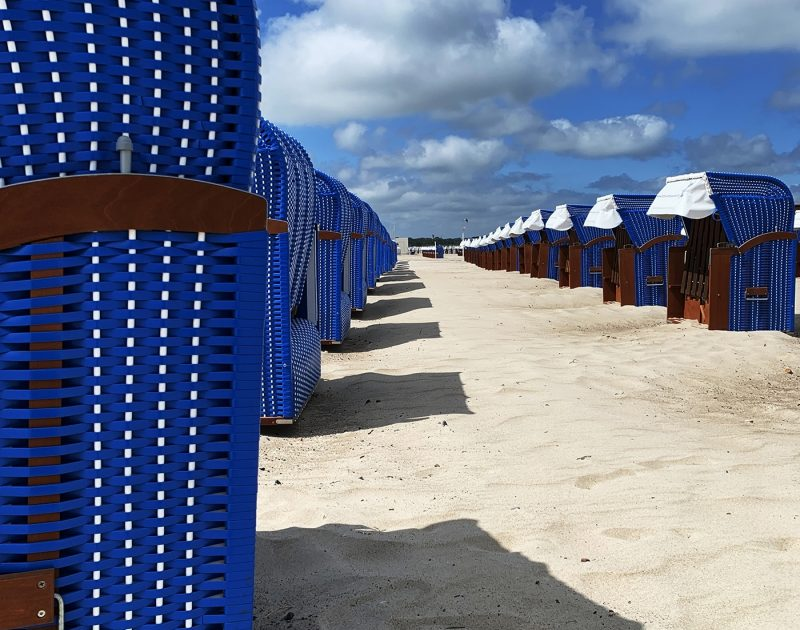 Blue chairs on sand in Warnermude