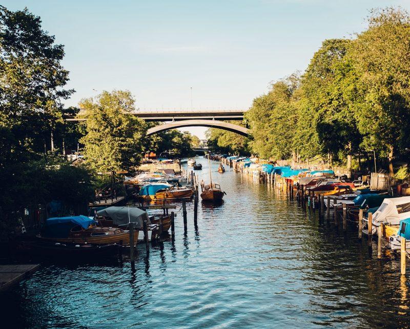 Boats on the lake, canoe in distance on Långholmen, Stockholm, Sweden