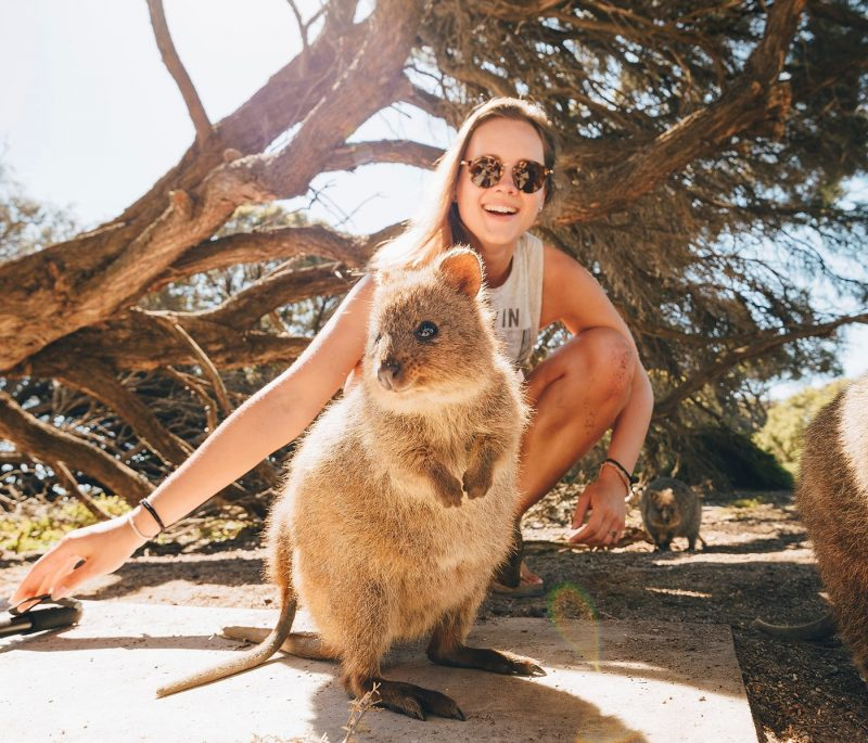 Girl posing with Quokka in Perth