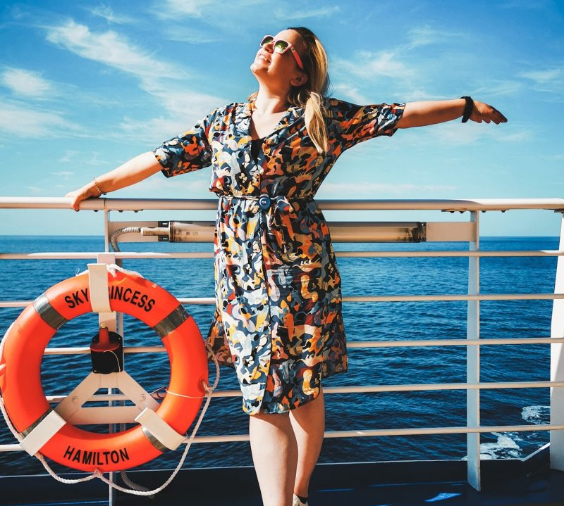 Blogger Tara Povey overlooks the gorgeous blue sea from a Sky Princess deck