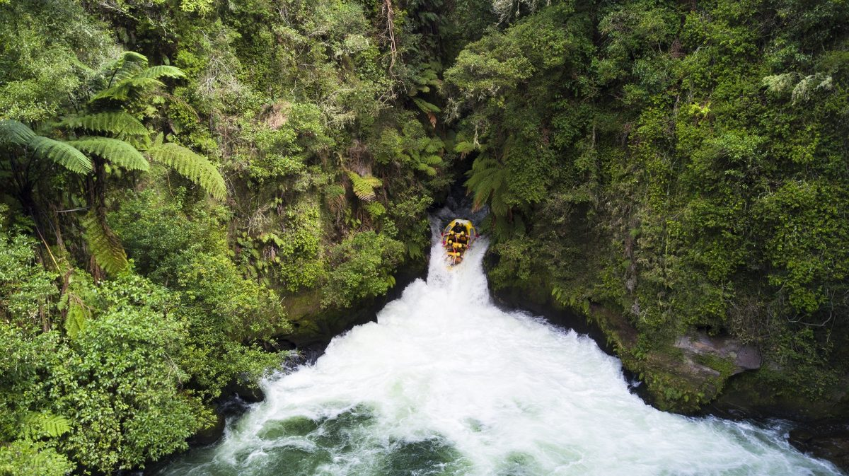 Raft going over waterfall in New Zealand