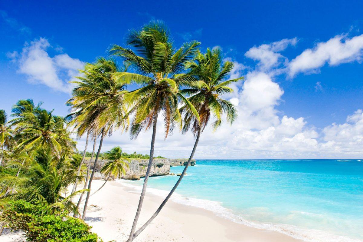 Blue sea and white sandy Barbados beach