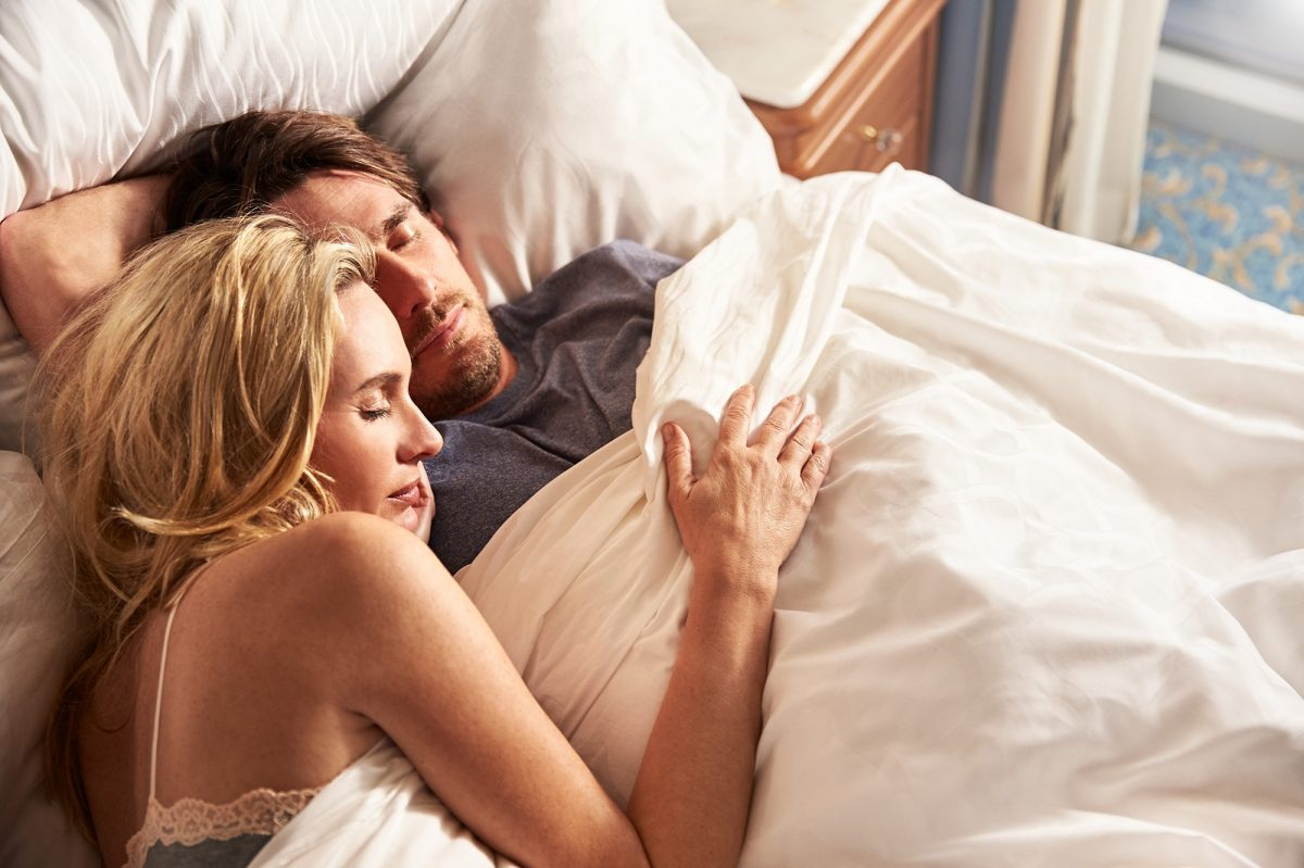 Couple sleeping on Princess bed