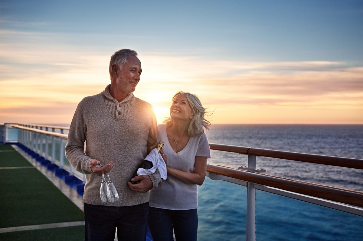 Couple at dreamy sunset on ship