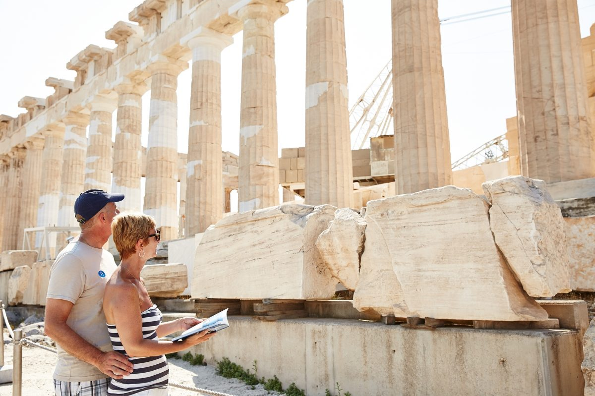 Couple looking at the Acropolis on sunny day ,Greece
